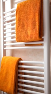 Modern contemporary bathroom radiator combining central heating and drying facilities
